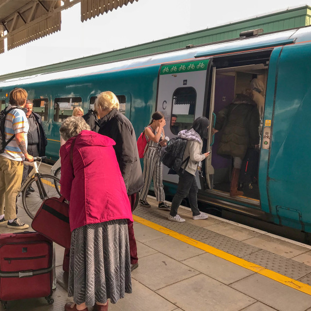 """Rail passengers on a platform"" stock image"