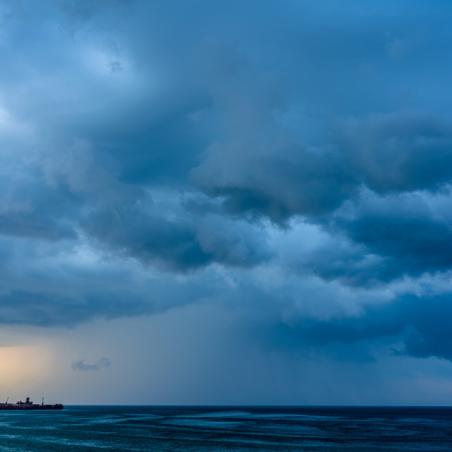 """Storm Clouds Gathering Over Shipwreck Ocean"" stock image"