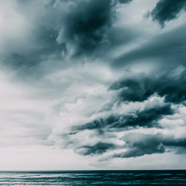 """""""Storm Clouds Gathering Over Ocean"""" stock image"""