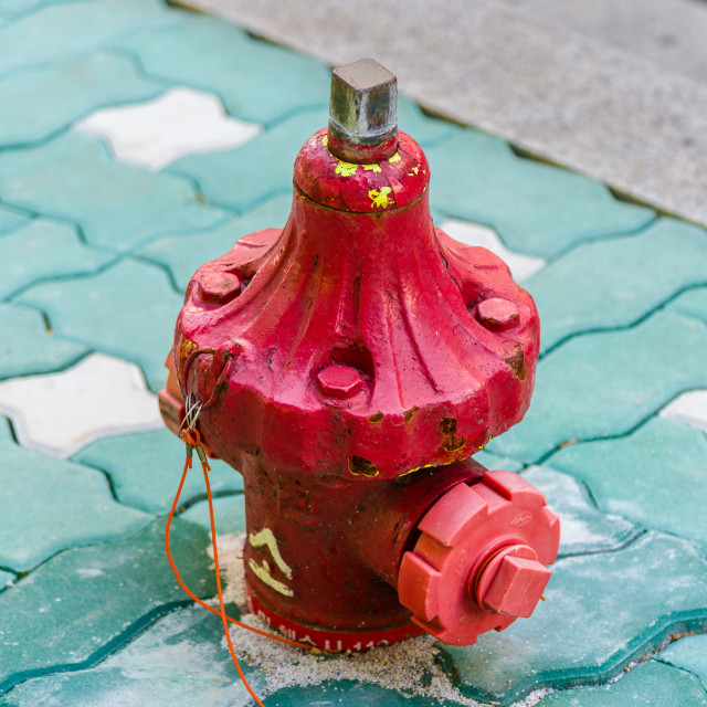 """A tiny fire hydrant on the street in Seoul, South Korea"" stock image"