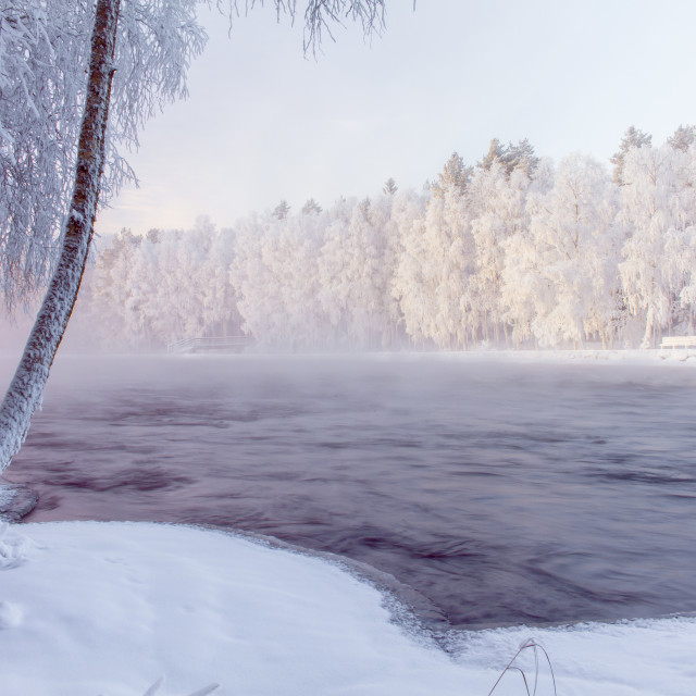 """Snowy river view from Kuhmo, Finland."" stock image"