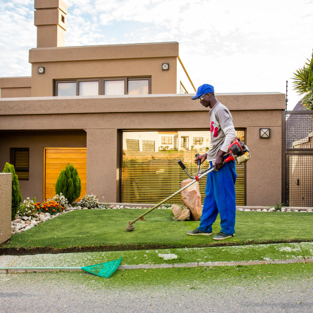"""Africa _ Strimmer Man"" stock image"