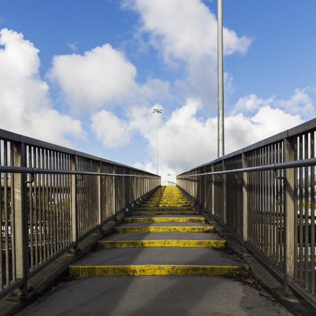 """""""Urban walkway against blue sky with cloud"""" stock image"""