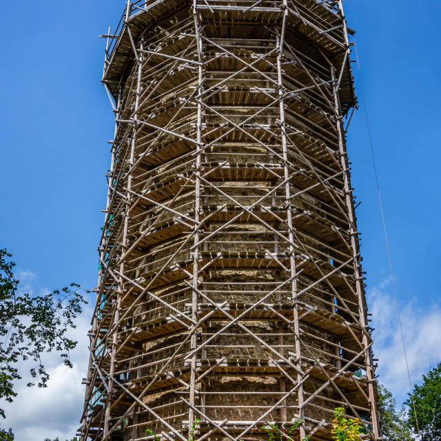 """""""Ancient tower with wooden scaffolding around and with historic crane on roof"""" stock image"""