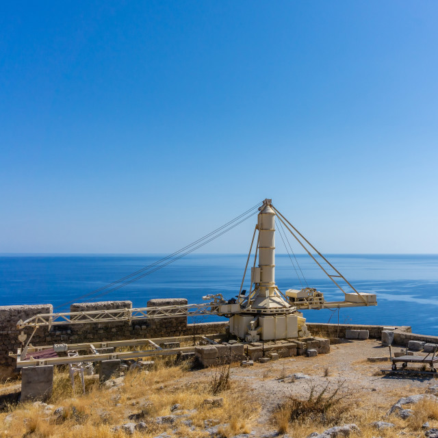 """""""Old heavy crane on the top of Acropolis above ancient town Lindos on Rhodes..."""" stock image"""