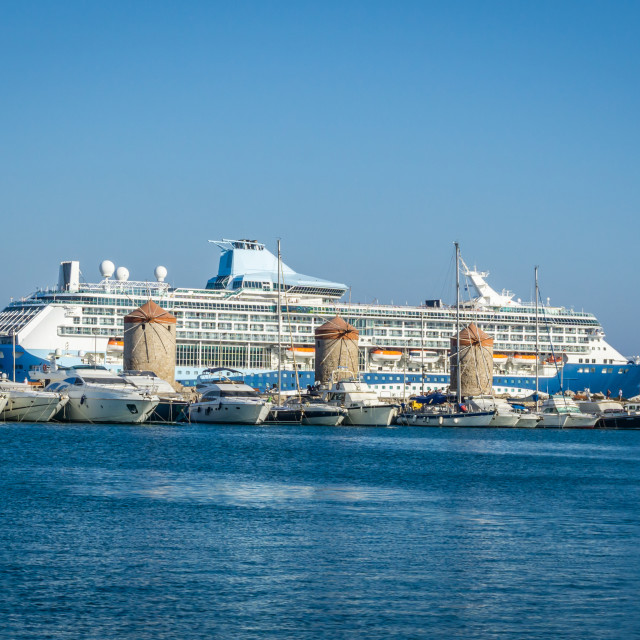 """""""Big cruiser behind ancient mills in capital town of Rhodes island"""" stock image"""