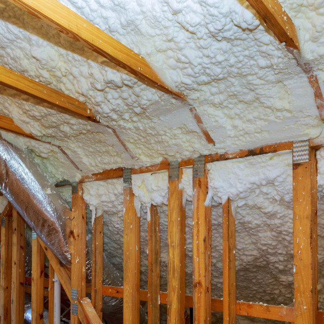 """New home construction with installation of termal insulation installing at..."" stock image"