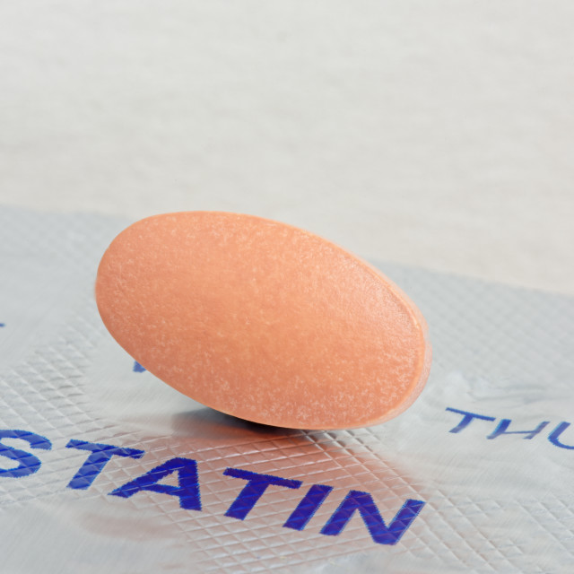 """Close up of a Statin Tablet on a Blister Pack"" stock image"