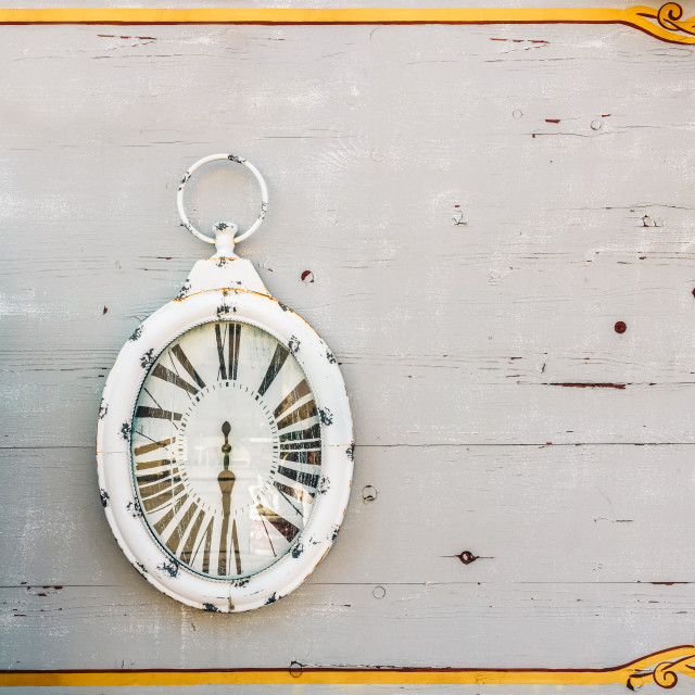 """""""White Antique Clock On Wood Wall"""" stock image"""