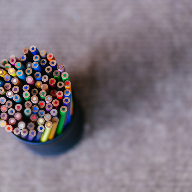 """""""Pencil Holder Holding a Variety of Colored Pencils on a Grey Textured Background"""" stock image"""