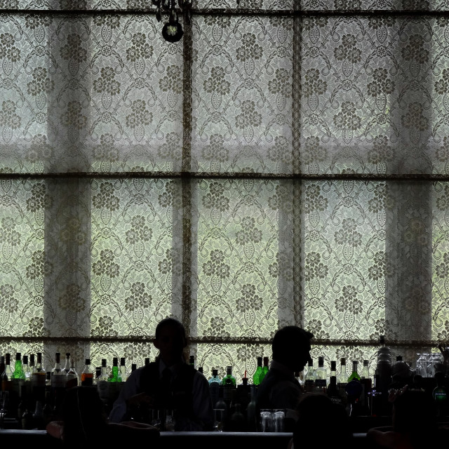 """""""Two bartenders in silhouette against a lace curtain, Adare Manor Golf Club, Limerick, Ireland"""" stock image"""