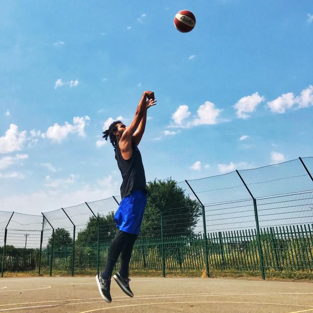 """""""basketball player shooting"""" stock image"""