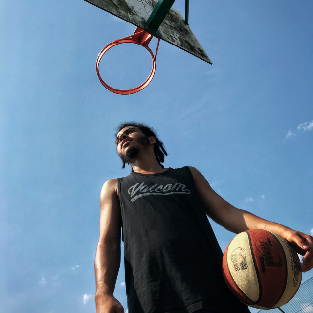 """""""A basketball player in front of hoop"""" stock image"""