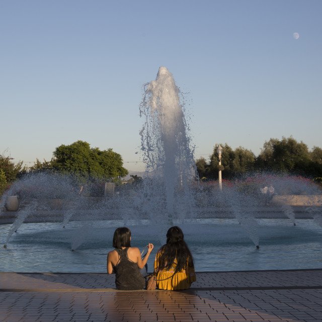 """Fountainside conversation"" stock image"