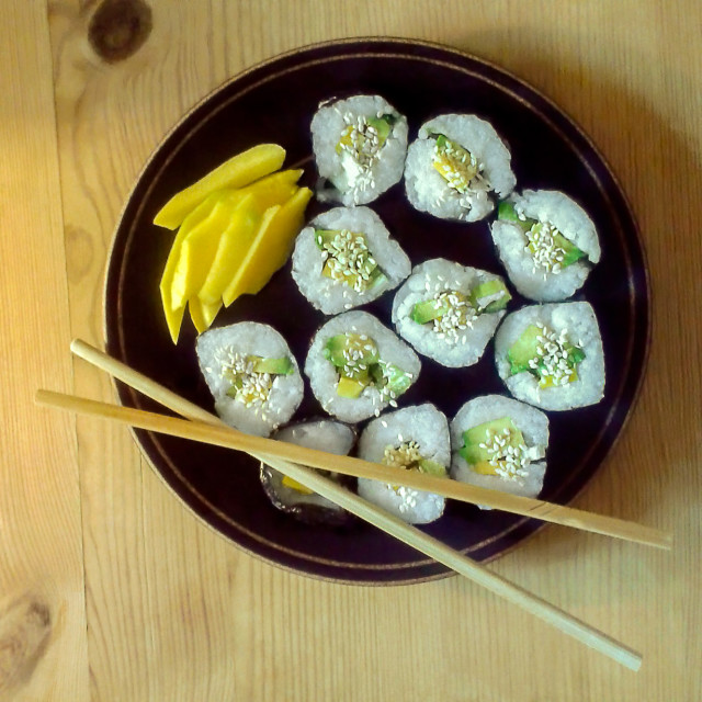 """Top view of a black plate with vegan homemade maki sushi rolls w"" stock image"