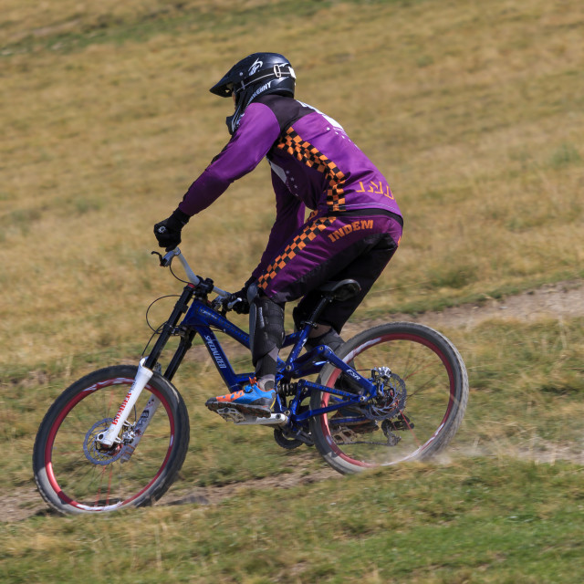 """Man riding mountain bicycle downhill"" stock image"