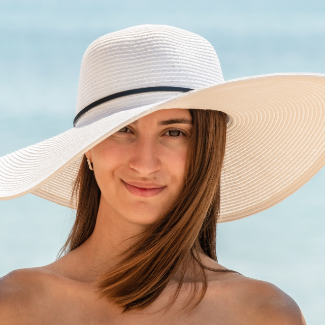"""""""Young Woman Portrait With White Beach Hat"""" stock image"""
