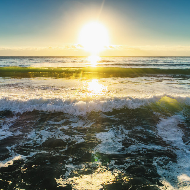 """""""Aerial view of ocean waves at sunrise"""" stock image"""