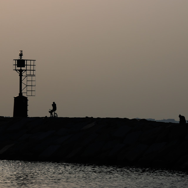 """dusk at sea and human silhouettes summer season"" stock image"