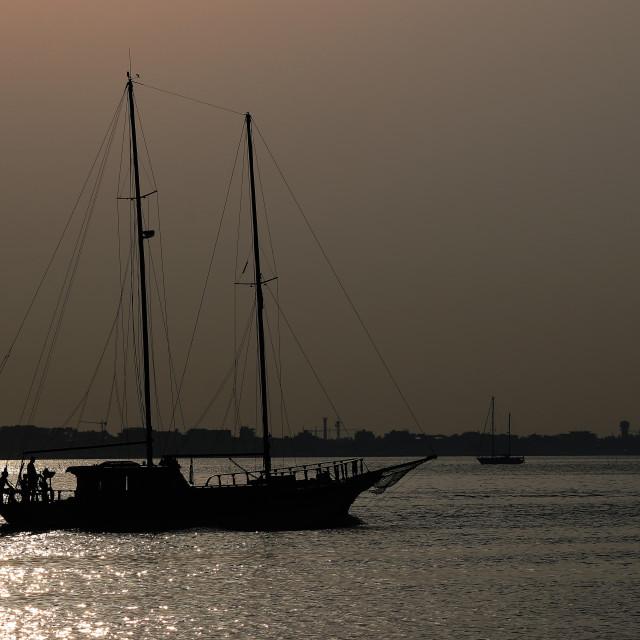 """yacht silhouette at sea summer season"" stock image"