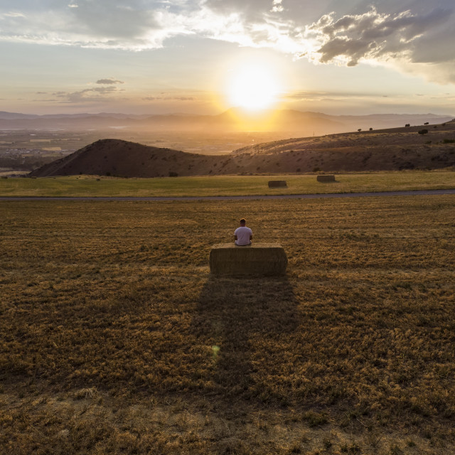 """""""Looking out to a vast farming landscape at sunset; Hyde Park, Utah, United..."""" stock image"""