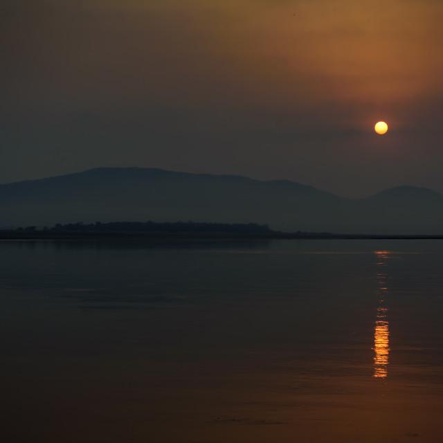 """Sunrise over Mahanadi river, Odisha, Eastern Ghat mountain range"" stock image"