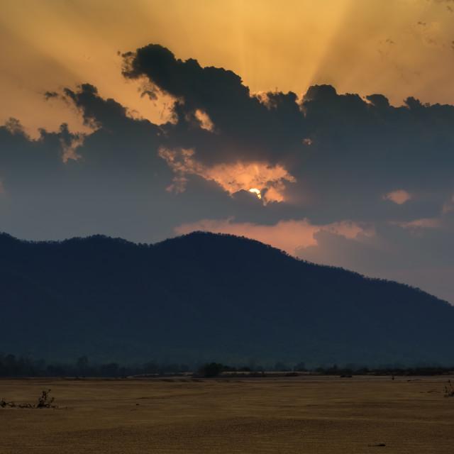 """Sun settin behind Eastern Ghat Mountain range over Mahanadi rive"" stock image"