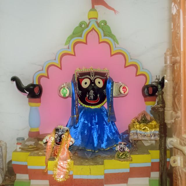 """Idol of Lord Jagannath, a Hindu God, inside a temple"" stock image"
