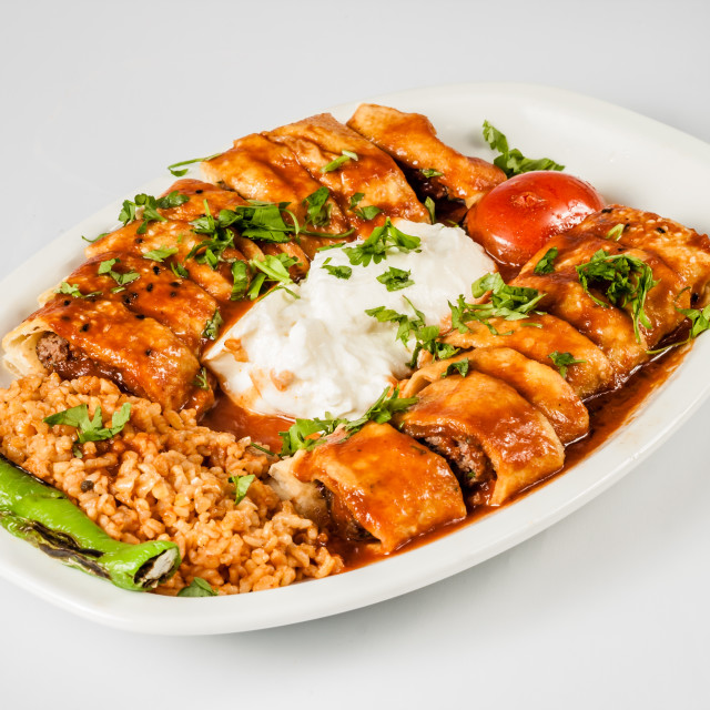 """Turkish Beyti Kebab Served with Bulgur Pilaf and Yoghurt"" stock image"