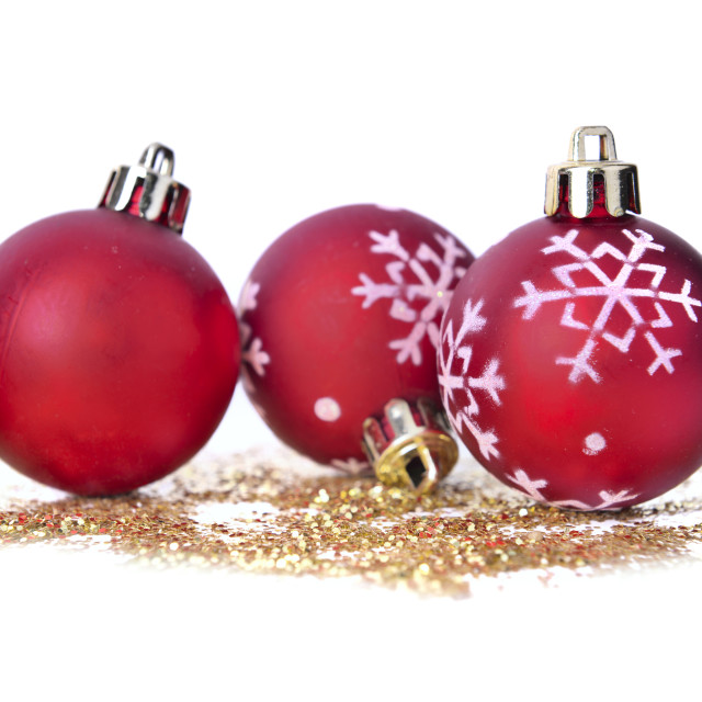 """christmas baubles on golden glitters"" stock image"