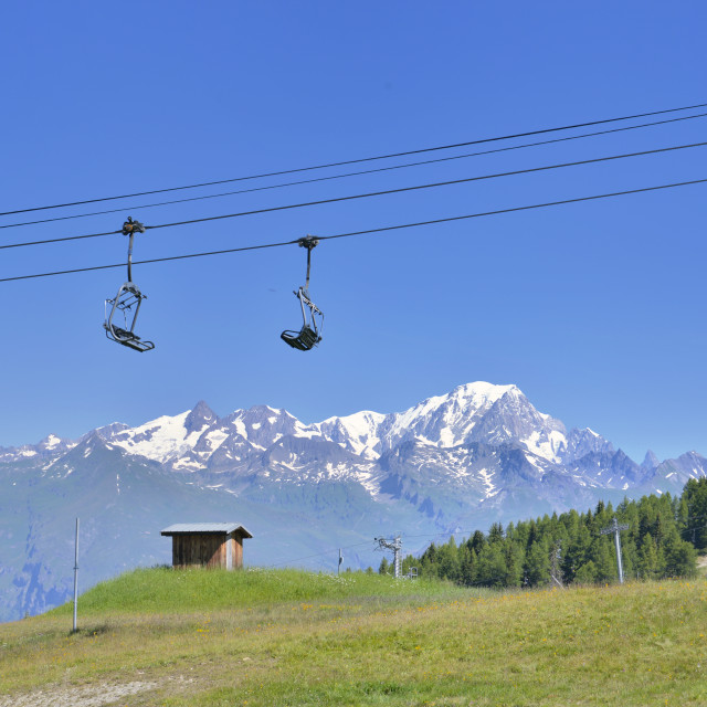 """chairlift in front of snowy mountain"" stock image"
