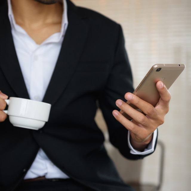 """Arab beard businessman use smartphone in coffee time"" stock image"