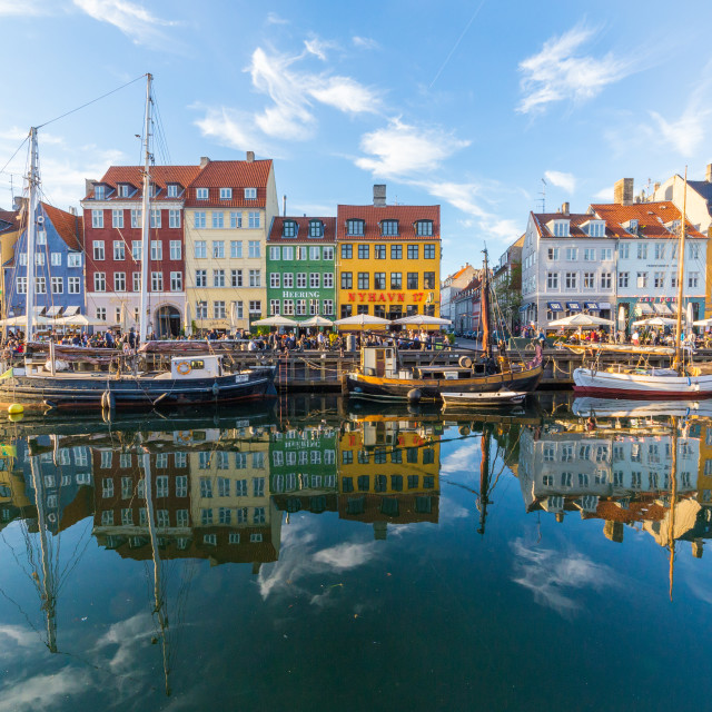 """Buildings, architecture, boats and reflections along the Nyhavn"" stock image"