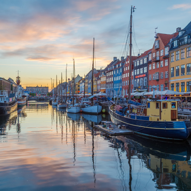 """View of boats and buildings along the Nyhavn at sunset"" stock image"