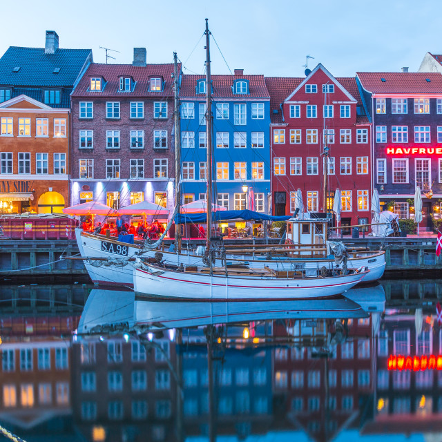 """Architecture and boats along the Nyhavn in the evening"" stock image"