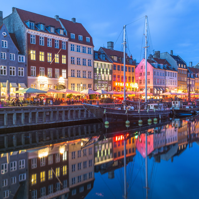 """Architecture and boats along the Nyhavn at night"" stock image"