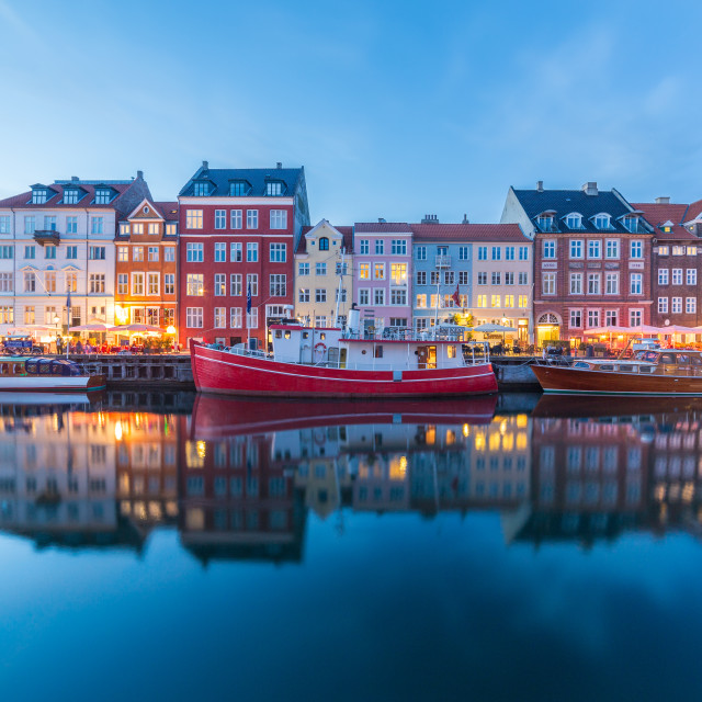 """View of boats and buildings along the Nyhavn at night"" stock image"