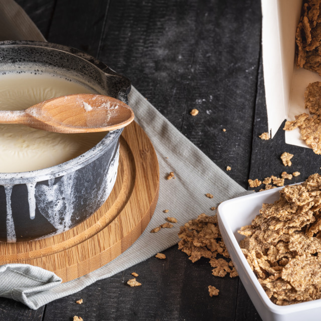 """""""Whole grain cereals and milk in a saucepan"""" stock image"""