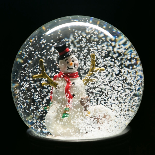 """Winter Snow Globe With Snowman on Black"" stock image"