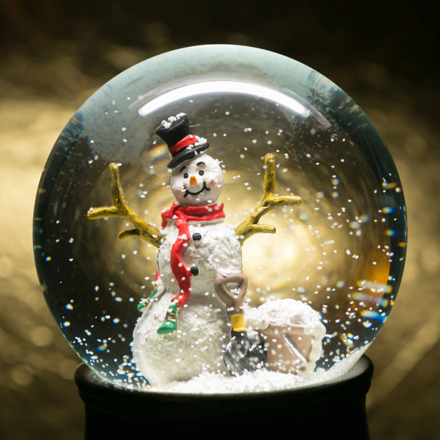 """Winter Snow Globe With Snowman on Gold"" stock image"