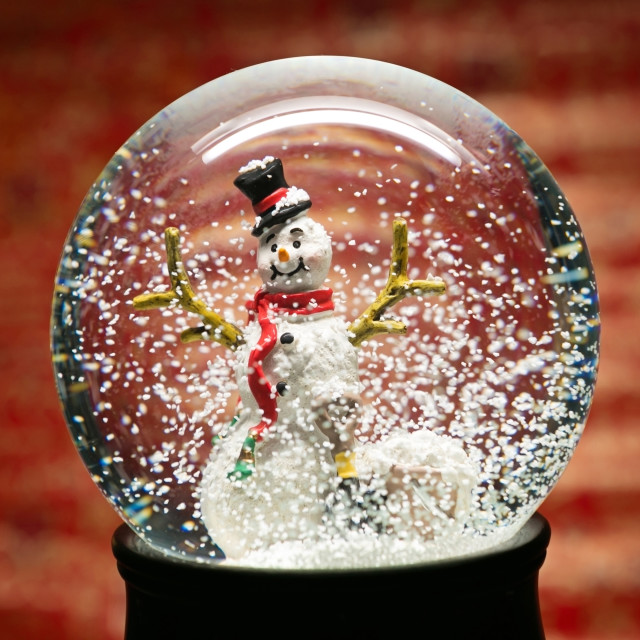 """Winter Snow Globe With Snowman on Red"" stock image"
