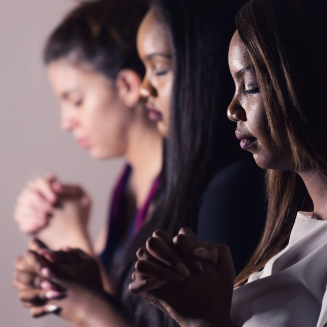 """""""Young Devoted Women Praying Together"""" stock image"""