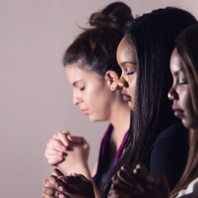 """Young Devoted Women Praying Together"" stock image"