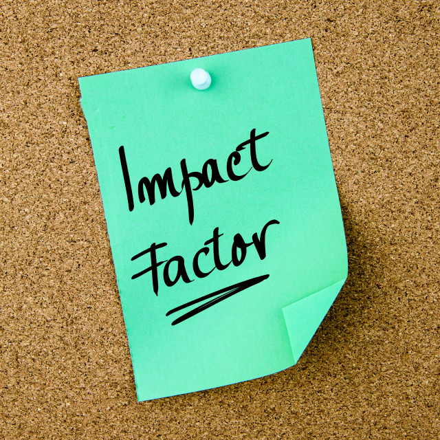 """""""Impact Factor written on green paper note"""" stock image"""