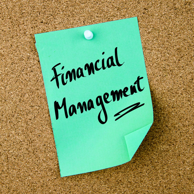 """""""Financial Management written on green paper note"""" stock image"""