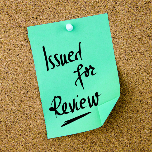 """""""Issued For Review written on green paper note"""" stock image"""