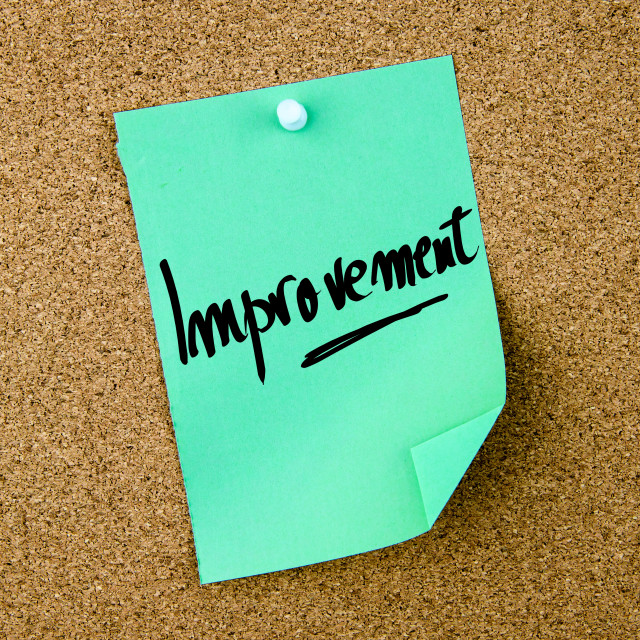 """""""Improvement written on green paper note"""" stock image"""