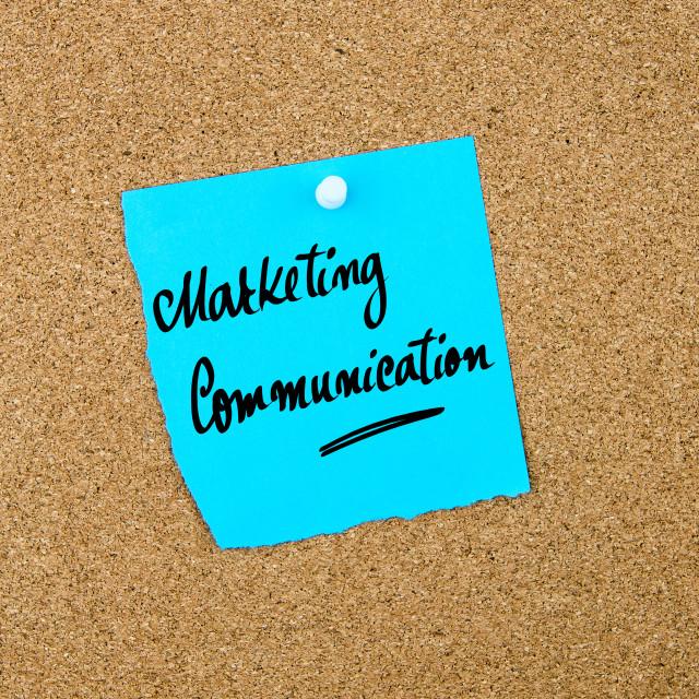 """Marketing Communication written on blue paper note"" stock image"