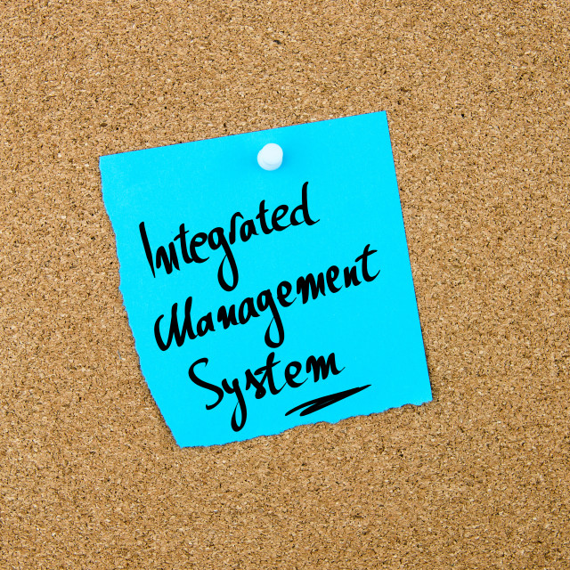 """""""Integrated Management System written on blue paper note"""" stock image"""