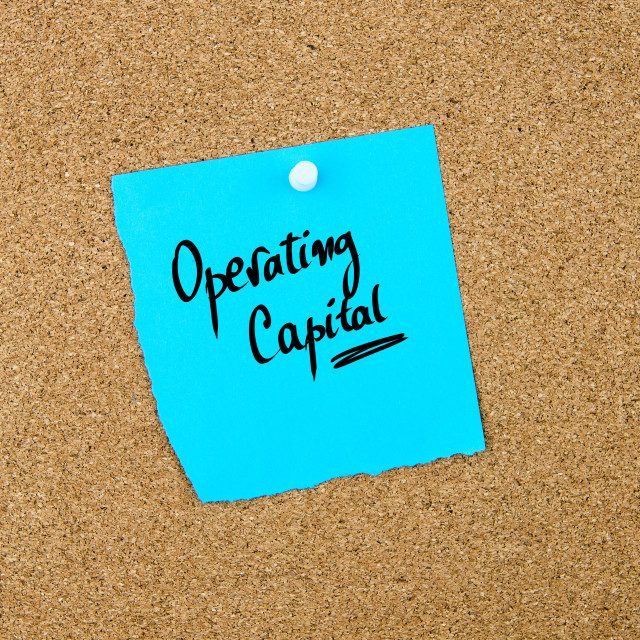 """""""Operating Capital written on blue paper note"""" stock image"""